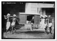 four-indians-carrying-palanquin-india